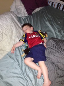 Usually he watches games the same way I prefer to: in his jersey, in bed, with his eyes closed.
